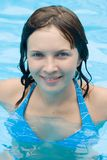Woman in the pool. Young woman in the pool smiling to you Royalty Free Stock Photography