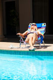 The woman on the pool area Royalty Free Stock Photography