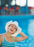 Woman at pool bar enjoying vacation Stock Images
