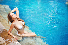 Woman in a pool royalty free stock images