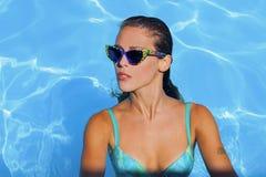 Woman at pool Stock Photo