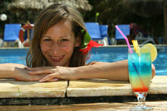 Woman in pool with cocktail Royalty Free Stock Photo