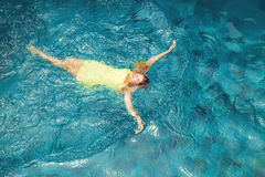 Woman in a pool. Happy woman swimming in a pool royalty free stock images
