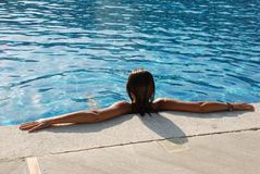 Woman in pool or jacuzzi. Back of a woman in a pool or jacuzzi at a resort Stock Image