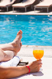 The woman at pool with a juice glass Royalty Free Stock Photos