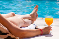 The woman at pool with a juice glass Stock Image