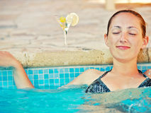 Woman at the pool. With martini cocktail Stock Photography