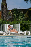 Woman on the pool Stock Photography
