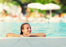 Woman in a pool Stock Image