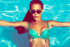 Woman in pool. Young attractive woman in  in pool with sunglasses  above view Royalty Free Stock Photos