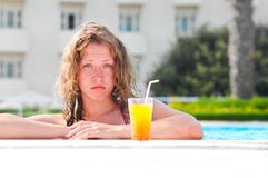 Woman at poolside Royalty Free Stock Photography