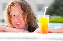 Woman at poolside Stock Photos