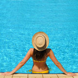 Woman at poolside Stock Images