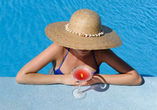 Woman at poolside with cosmopolitan cocktail Stock Photo