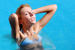 Woman in poolside Stock Photo