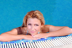 Woman in poolside Stock Photos