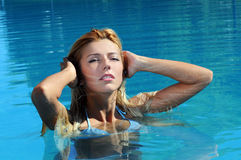 Woman in poolside Stock Images