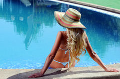 Woman in poolside Royalty Free Stock Photo