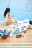 Woman at poolside Royalty Free Stock Image