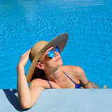Woman at poolside Stock Image