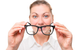 Woman with poor eyesight wears glasses Royalty Free Stock Image