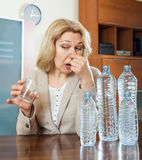 Woman with  poor quality water Stock Images