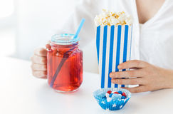 Woman with popcorn and drink in glass mason jar Royalty Free Stock Image