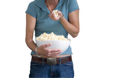 Woman with popcorn, mid section, cut out Stock Image