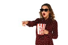 Woman with popcorn watching action movie in 3d glasses. Young emotional woman with popcorn watching action movie in 3d glasses. White isolated background Stock Images