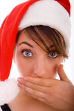 Woman with popped eyes wearing christmas hat Stock Image