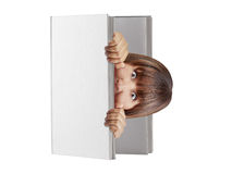 Woman popping out blank hard cover book looking surprised scared isolated Stock Photo