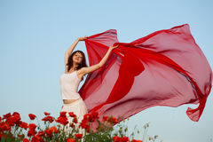 Woman in poppy field Royalty Free Stock Image