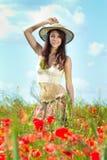 Woman in poppy field Stock Image