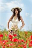 Woman in poppy field Royalty Free Stock Photo