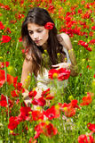 Woman in poppy field Royalty Free Stock Photography