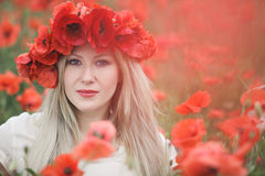 Woman and Poppy Flowers Stock Image