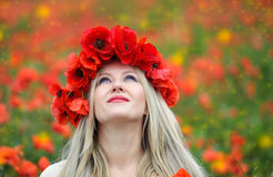 Woman and Poppy Flowers Royalty Free Stock Photography