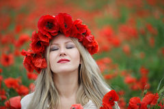 Woman and Poppy Flowers Royalty Free Stock Photos