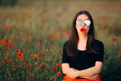 Woman with a Poppy in Her Mouth Fashion Portrait royalty free stock photos