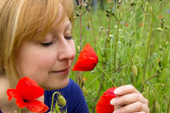 Woman with a poppy Stock Photos