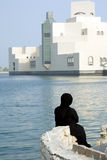 Woman in port. Arabic woman watching islamic museum of doha Royalty Free Stock Photography