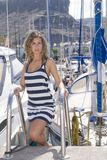 Woman in a port in her ship with blue sky Royalty Free Stock Photography