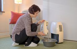 Portable dehumidifier colect water from air royalty free stock photo