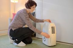 Portable dehumidifier colect water from air royalty free stock photography