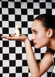 Woman portrait. Woman in profile with a chess piece in hand Stock Image