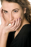 Woman portrait. Woman's portrait from hands near face Royalty Free Stock Images