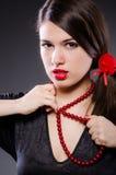 Woman portrait against dark background Stock Photos