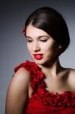 Woman portrait against dark background Royalty Free Stock Photo