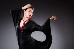 Woman portrait against dark background Stock Photography