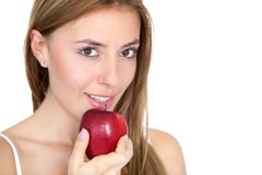 Woman portrait with an apple Royalty Free Stock Image